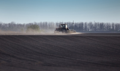 Tractor plowing field