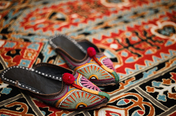 Asian interior. Carpet and slippers