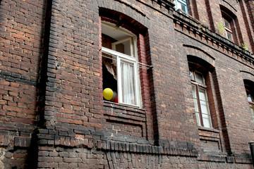 happy balloons in window frame in polish street