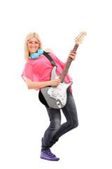 Beautiful blond woman playing an electric guitar