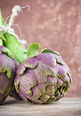 Closeup of an artichoke on wooden table