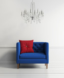 Blue buttoned couch in a white interior