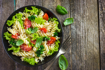 Pasta salad with cherry tomatoes and broccoli