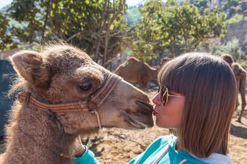 Girl kissing camel