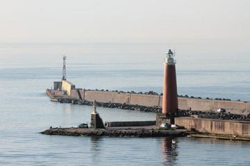 Pier, beacon, sea. Naples, Italy