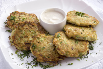 The zucchini pancakes with sour cream.