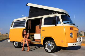 sexy woman sitting in a camper bus - roadtrip