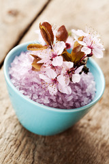 Spa concept: bowl with bath salt and flowers