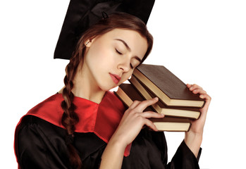 Beautiful graduate girl student in mantle with books