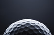 Macro golf ball on dark blue  background, space for text. - 81677637