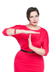 Beautiful plus size woman in red dress showing time out gesture
