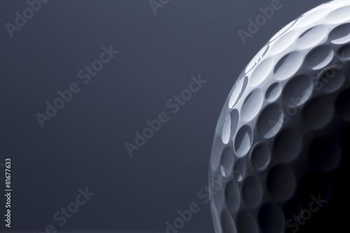 Stylish golf ball isolated on empty dark blue background. - 81677633