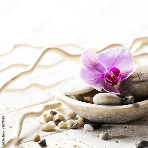 Leinwandbild Motiv symbols of purity with stones and pebbles