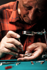 Senior watchmaker repairing an old pocket watch