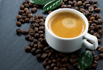 cup of espresso on coffee beans background, horizontal