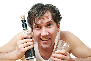 Funny drunk man with bottle of vodka and glass closeup