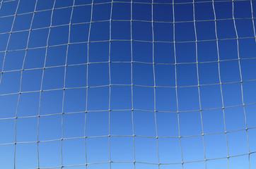 Soccer Net Background with Blue Sky