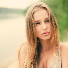 portrait of a beautiful girl on a sunny beach in summer