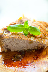 Bright photo of baked meat with basil leaf