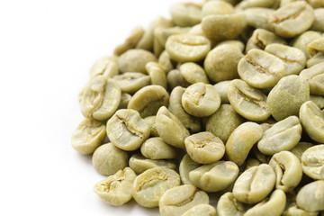 green (white) coffee beans on white background