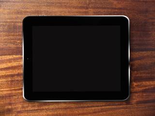 Tablette tactile sur fond de bois