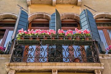 Traditional balcony in a venetian alley