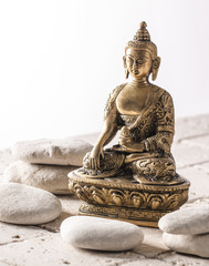 Buddha for zen attitude on mineral background