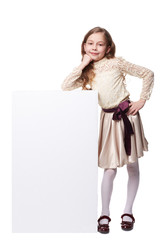 Little girl with empty banner blank sheet of paper
