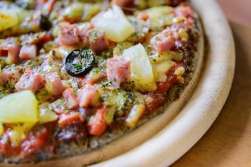 pizza Hawaiian thin crust pizza.