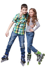 Boy and girl with roller skating hug themself in a studio