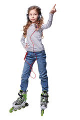 Little girl with earphones in roller skates pointed up