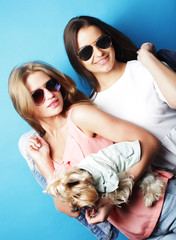 two teenage sisters with Yorkshire Terrier