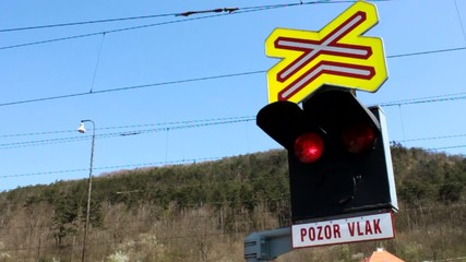 """Traffic lights at a level crossing, the sign """"beware train"""""""