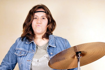 Studio shot of a young lady on drums