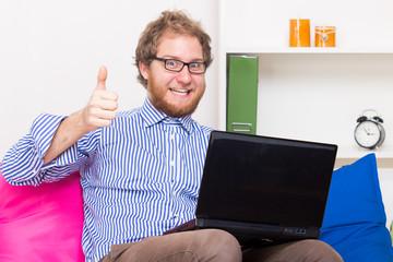 Man has joy at the computer