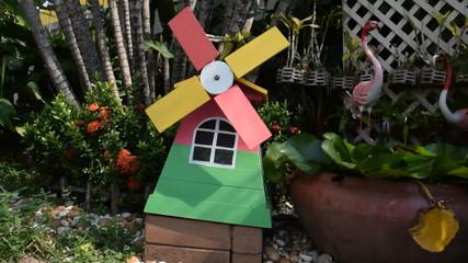 small wood turbine on green garden