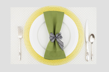 Green and yellow table place setting