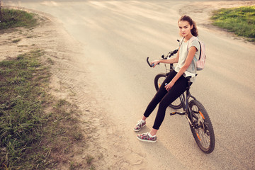 beautiful young girl and bicycle