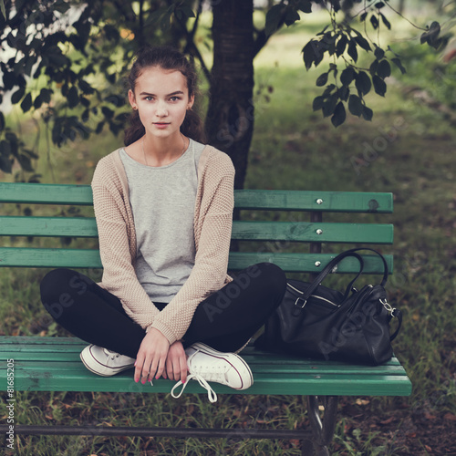 beautiful hipster girl sitting on the bench