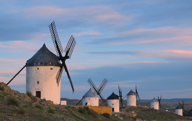Blue sky and windmills in the background, Consuegra,  Toledo.