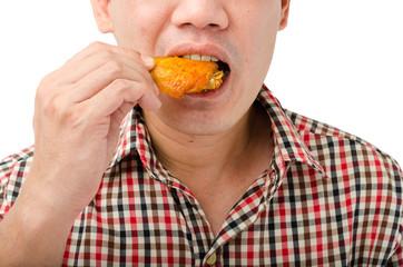 man eating chicken wing