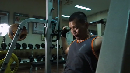 Exercising in the gym,Man tired after finishing.