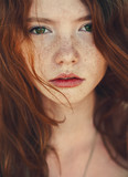 portrait of a cute red-haired girl close-up - Fine Art prints