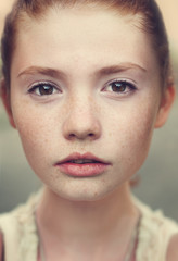 portrait of a beautiful young girl with freckles