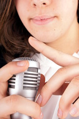 Close up of fingers check a microphone