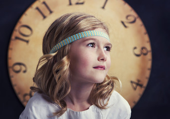 Young girl with large vintage clock