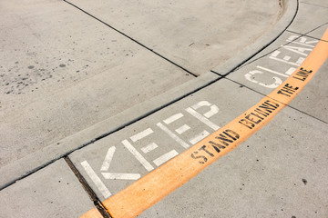 Keep clear safety curb sidewalk road marking