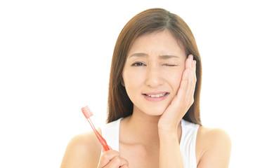 歯痛を訴える女性