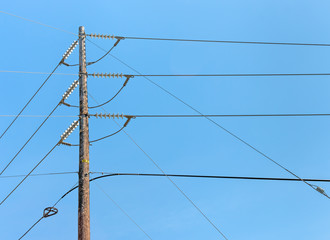 High voltage electricity wood utility pole distribution lines