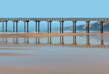 Scripp's pier and reflection in the wet sand,San Diego, CA